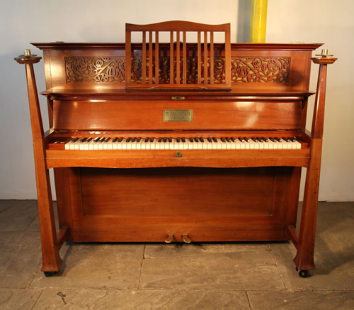 Bechstein Upright Piano with an Arts and Crafts Mahogany Case with Sculptural Candlesticks and Ornate Hinges.