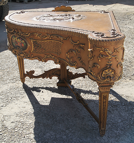 Claviano grand piano built for songwriter and film star Ivor Novello. This piano has an ornately carved, rococo style case with gilt accents