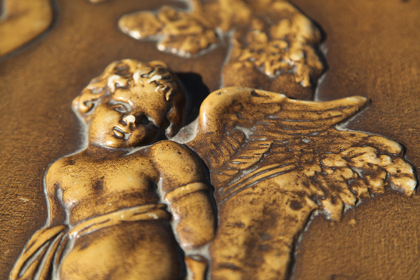 Claviano piano lid showing detail of carved cherub