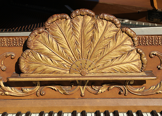 Detail of golden feather fan music stand