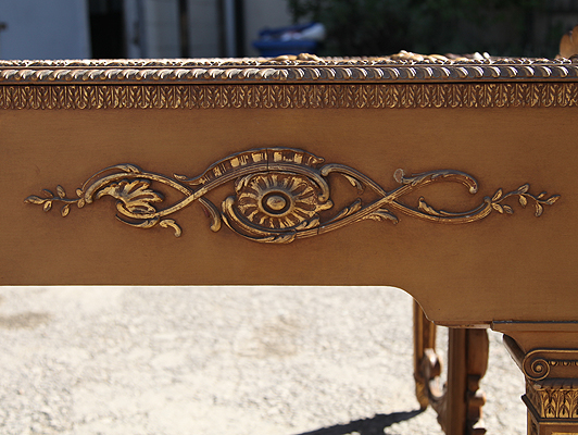 Claviano cabinet showing ornate rococo carvings with gilt accents