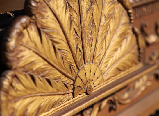 Carved golden feather fan detail