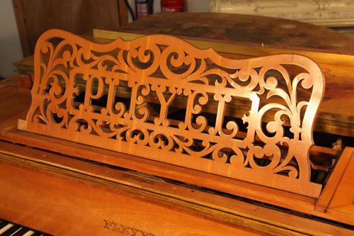 Pleyel Music Desk Cut Out with the Company Logo