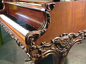Ecke Grand Piano for sale.