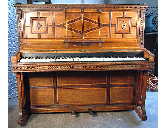 Hopkinson upright piano with a polished, rosewood case, inlaid with a variety of woods and carved detail