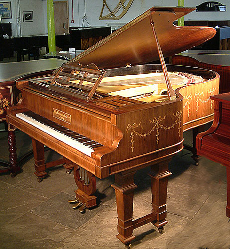 John Brinsmead and Sons grand piano with a polished rosewood case. Adam style swags and bows inlaid around case