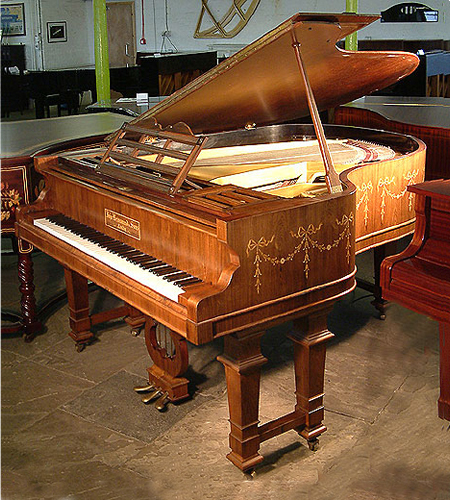 Art Cased, John Brinsmead and Sons grand piano with a polished rosewood case. Adam style swags and bows inlaid around case