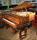 Piano for sale. An inlaid John Brinsmead and Sons Grand. Adam style swag detail around case.