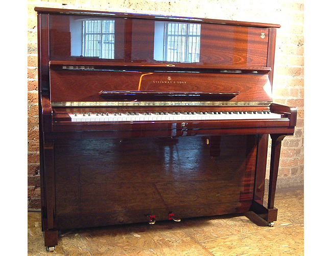 A brand new, Steinway Model K Upright with a mahogany case and polyester finish
