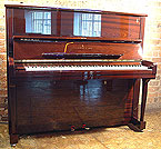 Piano for sale. A brand new, Steinway Model K Upright with a mahogany case and polyester finish.