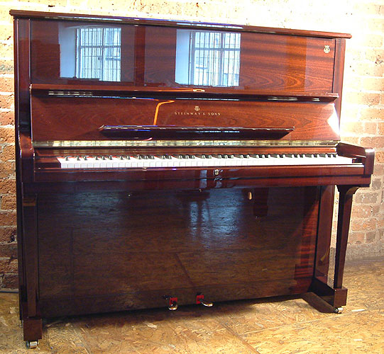 A Steinway Model K  upright piano for sale with a mahogany case.