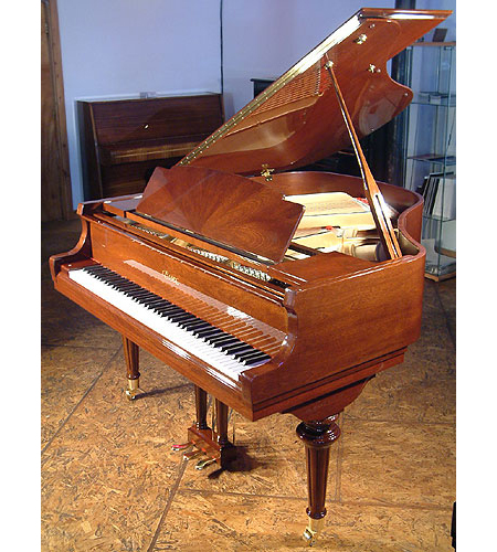 A brand new Essex EGP155 baby grand piano with a walnut case and polyester finish