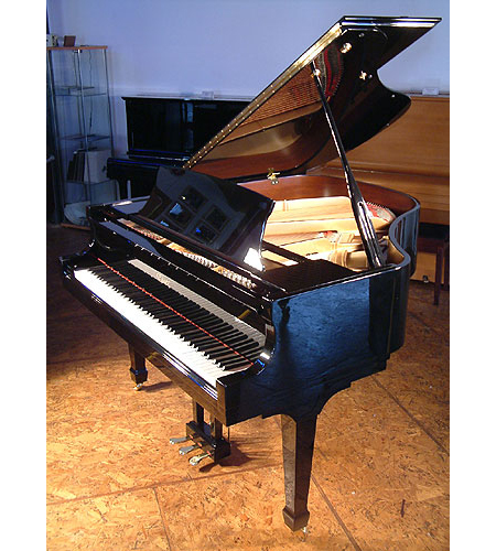 A brand new Essex EGP155 baby grand piano with a black case and polyester finish