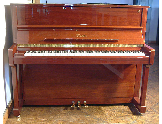 A brand new Essex EUP-123 upright piano with a mahogany case and polyester finish