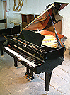 Piano for sale. A Boston GP193 grand piano with a black case and polyester finish.