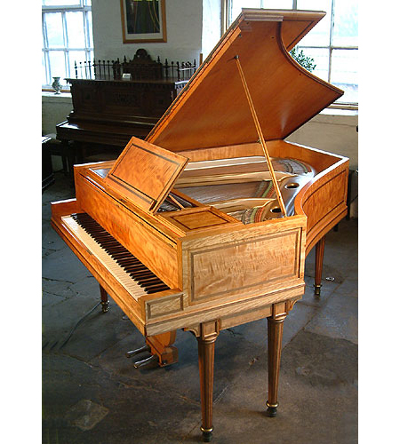 An 1898, Regency style Broadwood grand piano with a polished, satinwood case, delicately inlaid with rosewood and boxwood stringing