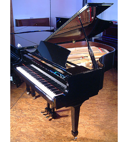 A brand new Essex EGP 173 grand piano with a black case and polyester finish