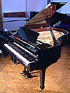 Piano for sale. A brand new Essex EGP 173 grand piano with a black case and polyester finish.