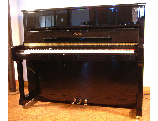 A brand new Essex EUP 123 upright piano with a black case and polyester finish
