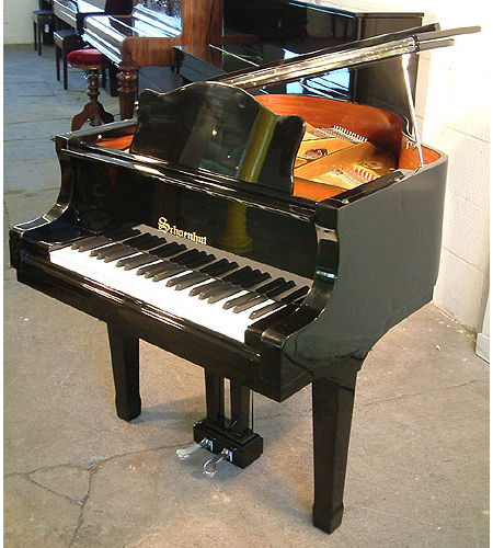 A brand new, Schoenhut half-size grand piano with a black case and polyester finish. Ideal to inspire a childs interest in the piano at a young age