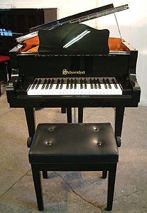 Schoenhut  Grand Piano for sale. We are looking for Steinway pianos any age or condition.