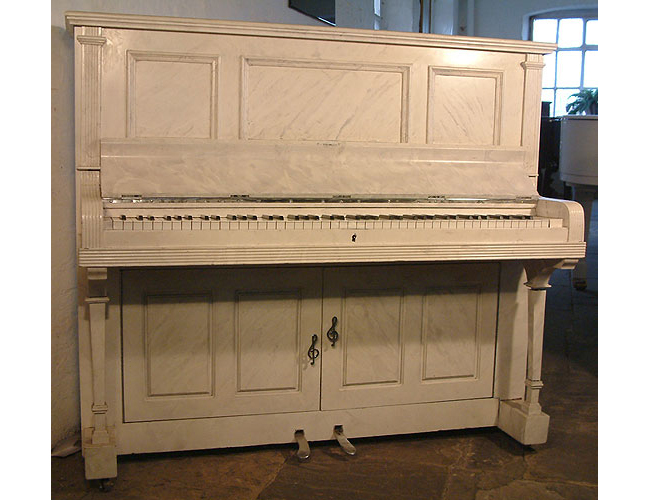 A  Besbrode upright piano and drinks cabinet. Case painted with Italian marble effect
