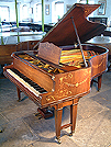 Piano for sale. A Schiedmayer grand piano with an inlaid, rosewood case.