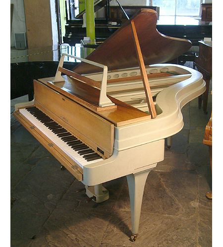 A 1959, Rippen grand piano with an aluminium case. This Rippen piano has a beautiful elegant outline. Piano features a reverse crown soundboard and tapered legs