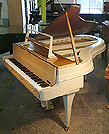 Piano for sale. A Rippen grand piano with an aluminium case.