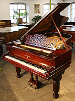 An 1889, Steinway Model B grand piano with a polished, rosewood case.