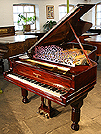 Piano for sale. An antique Steinway Model B grand piano with a polished, rosewood case.
