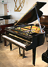 A Steinway Model S grand piano with a polished, black case. Piano designed by Swedish Architect Ivar Tengbom, representative of Swedish Neo-classical architecture. Designer of the Stockholm Concert Hall (1923 - 26) where the Nobel Peace Prize takes place.