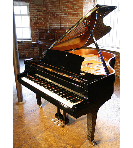 A brand new, Boston GP178 performance grand piano with a black case and polyester finish