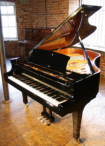 A brand new, Boston GP178 grand piano with a black case and polyester finish
