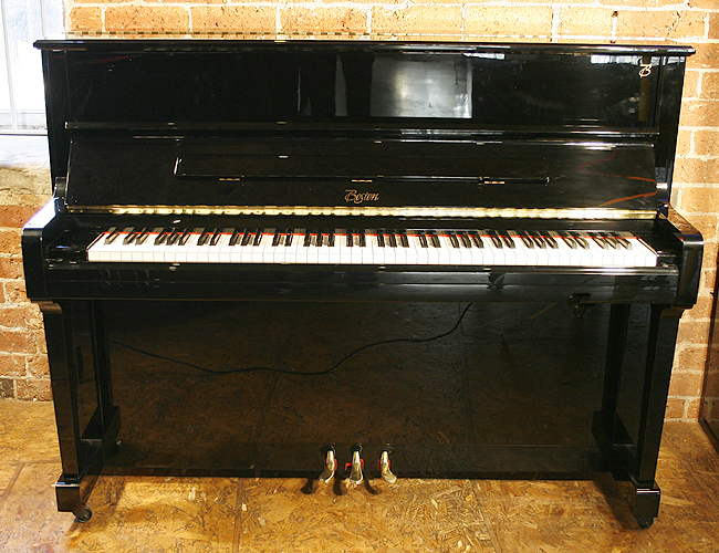 A Boston UP118 Performance Edition upright piano with a black case and polyester finish