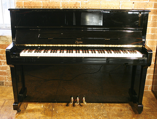 A brand new, Boston UP118 Performance Edition upright piano with a black case and polyester finish. Designed by Steinway and Son