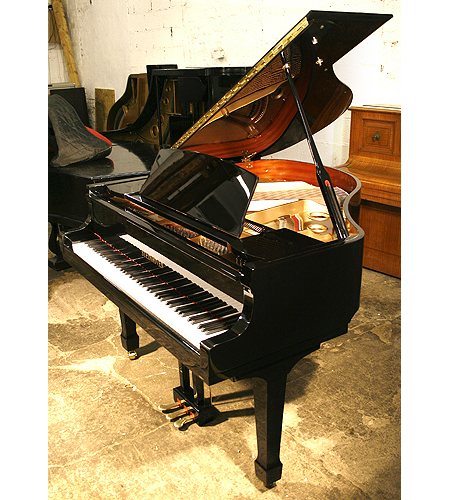 A brand new Steinhoven Model 148 baby grand piano with a black case and polyester finish