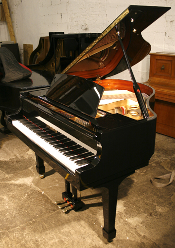 A brand new Steinhoven Model 148 baby grand piano with a black case and polyester finish.