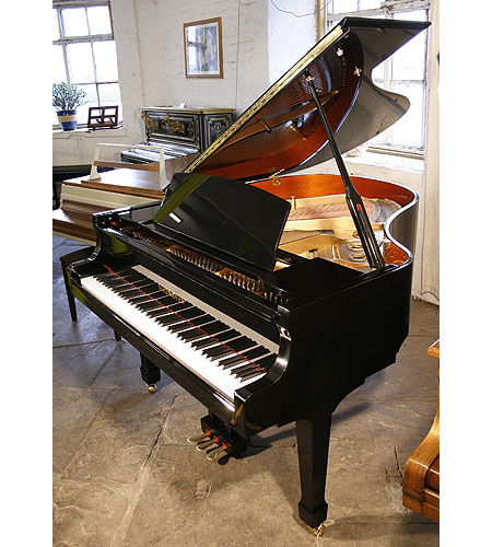 A brand new Steinhoven Model 170 grand piano with a black case and polyester finish