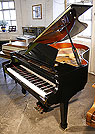 Piano for sale. A brand new Steinhoven Model 170 grand piano with a black case and polyester finish.