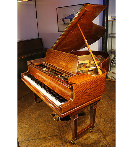 A 1906, Steinway Model O grand piano with a polished, satinwood case. Delicately inaid with boxwood stringing and crossbanding