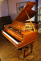 Steinway Model O grand piano with a polished, satinwood case. Delicately inaid with boxwood stringing and crossbanding