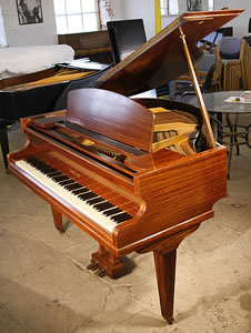 A 1936, Challen baby grand piano with a mahogany case, formerly the property of Hurricane Smith