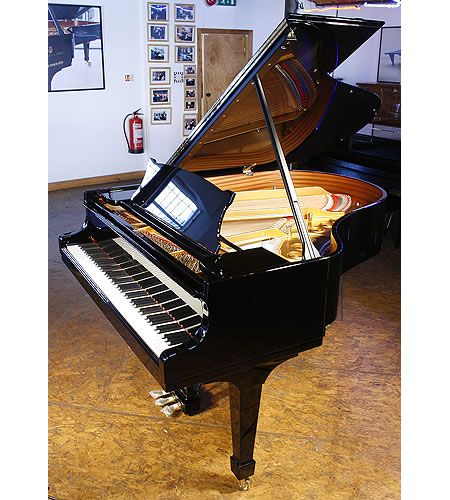 A brand new Steinway Model M grand piano with a black case
