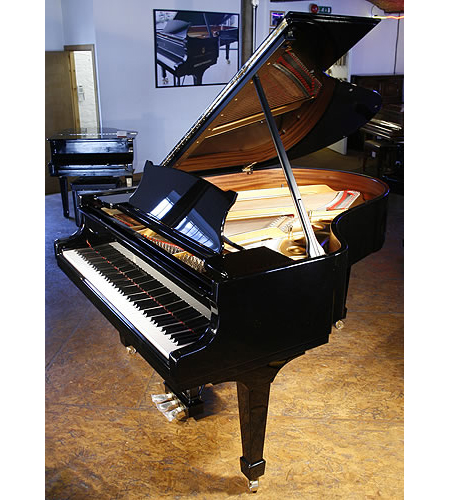 A Brand new Steinway Model O grand piano with a black case
