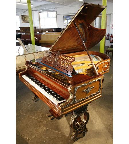 An 1897, Bechstein grand piano with a rosewood case in Louis XV, rococo style. Ornate, brass Ormulu Mounts cover the entire case