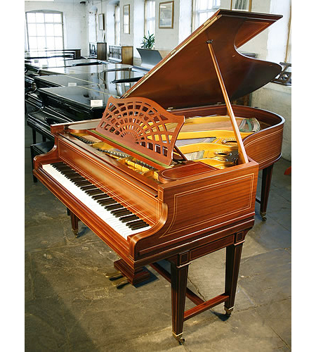A restored, 1883, Bechstein Model B grand piano with a mahogany case and gate legs, inlaid with satinwood stringing accents