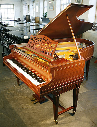A restored, 1883, Bechstein Model B grand piano with a mahogany case and gate legs, inlaid with satinwood stringing accents.