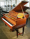 A restored Bechstein Model B grand piano with an inlaid, mahogany case. 