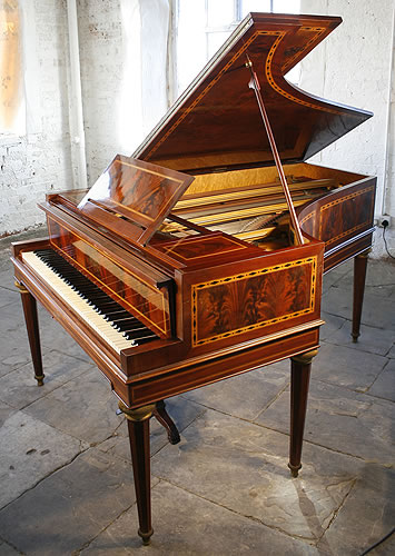 Erard grand piano for sale with an inlaid, mahogany case.